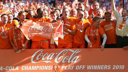 The Blackpool team celebrate after the final whistle during the Coca-Cola Football League Championsh