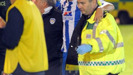 Colchester midfielder Andy Bond is taken off during the pre-season friendly between the U's and Ipsw