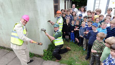 The scout hut in Eye is being demolished. Cllr Guy McGregor, Neil Bolger (scout leader) and Joan Nor