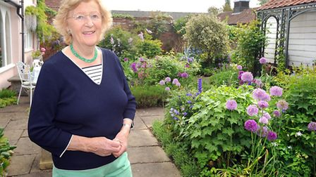 Boxford open gardens day. 21 gardens opened to the public. Pictured in her garden at Weavers House i