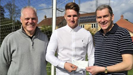 Club Colours Player of the Year Dan Heath, centre, receives his £50 cheque from Nick Garnham, right,