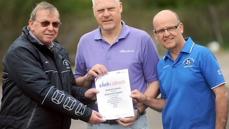 Ipswich Valley Rangers chairman Bob Pipe, right, and David Cattermole, left, receive the Club Colour