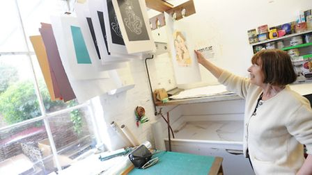 Artists prepare for the upcoming exhibition at Gainsborough Printworks in Sudbury. Sue Molineux hang