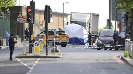 Police activity close to the scene where a man was murdered in John Wilson Street, Woolwich. PRESS A