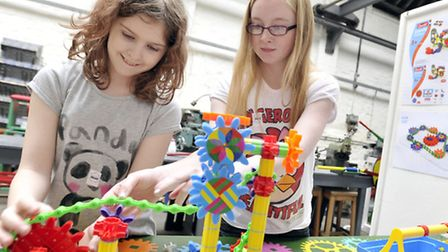 Saffron Jackson and Bryony Lawson make a cog and gear creation at Leistons Long Shop Museums Sprin