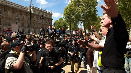 Kevin Carroll (right), co-founder and co leader of the EDL is confronted by Unite Against Fascism de