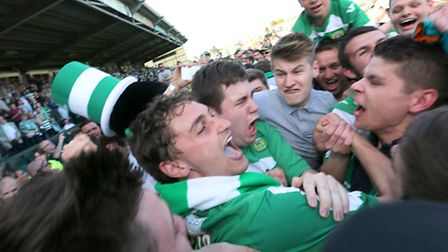 Ed Upson (centre) is mobbed by Yeovil fans after his late goal sealed a League One play-off semi-fin