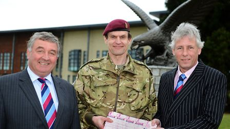 Pictured: Brigadier Giles Hill, Commander of 16 Air Assault Brigade, is presented with 400 family ti