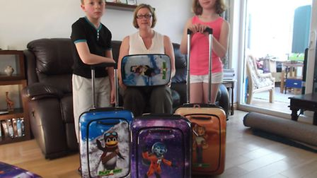 Business woman Jo Kerley with children Ben and Jessica and the Playaway cases for children she has i