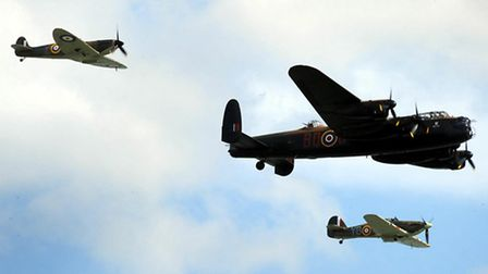 The Battle of Britain memorial flight, Lancaster bomber, spitfire and hurricane flies past the crowd
