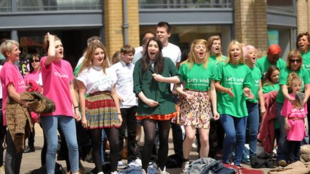 A flash mob of local singers (including Colchester Institute musical theatre students, Hythe Communi