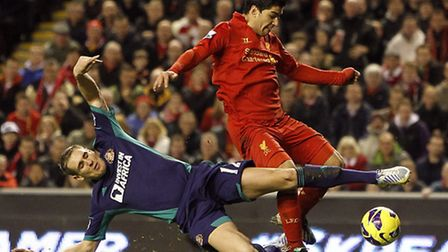 Matthew Kilgallon challenges Liverpool's Luis Suarez during Sunderland's game at Anfield back in Jan