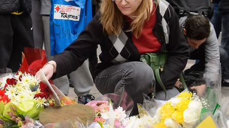 Ingrid Loyau-Kennett looks at floral tributes to Drummer Lee Rigby at the Royal Artillery Barracks