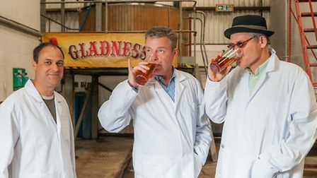 Paul Gower, left, head brewer at Nethergate's Growler Brewery, Madness frontman Suggs, centre, and