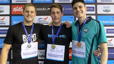 Bury St Edmunds swimmer Chris Walker-Hebborn (middle) with his 100m backstroke gold medal from the 2