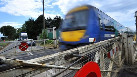 Lorry clips barrier at Manningtree level crossing.