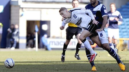 Lee Martin is brought down by Liam Trotter at The New Den last season. The two look set to become te