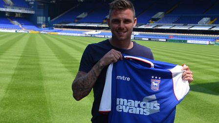 Paul Anderson has signed a two-year deal at Ipswich Town following a swap deal which has seen Jay Em