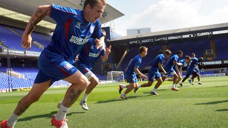 Ipswich Town players practice on the pitch at Portman Road during last summer's open day
