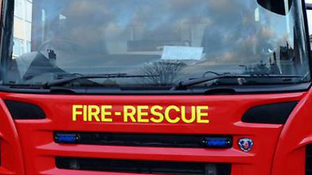 Firefighters have doused the flames which engulfed a shed tonight.