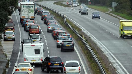 Commuters are facing delays after a lorry broke down at a busy junction between the A14 and A12.