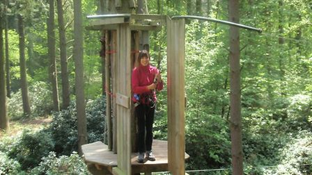 Reporter Mariam Ghaemi makes her way around the Tree Top Adventure at Go Ape at Thetford Forest.