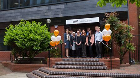 WNS Assistance staff outside its new offices in Museum Street, Ipswich