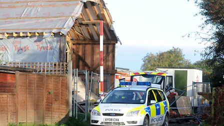 Police remain at the scene of the barn wall collapse in Worlingworth in 2010