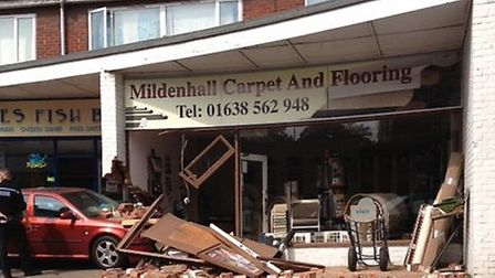 A car has crashed into the Mildenhall Carpet and Flooring shop in the High Street in Mildenhall. Pic