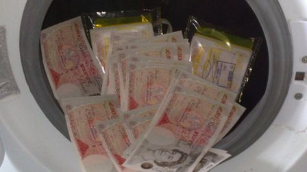The photo money-launderer Daniel Marks took of £50 notes in his washing machine.