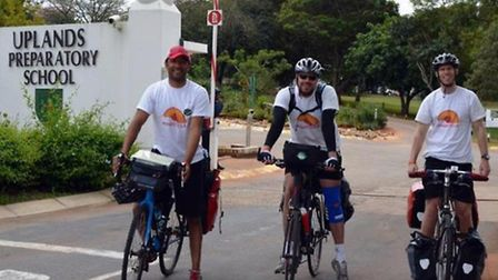 Jonan Boto (from Ipswich) with friends Steve Fleming and James Robinson on their bike ride through f