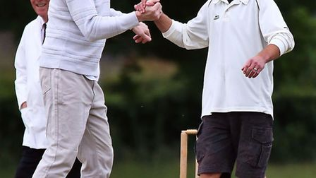 Kim Jansson Charity Cricket Match 26th June 2013 Leigh Lanham is congtratulated by Pete Simmons fo