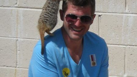 Meerkats climb over the children in our party and their dads