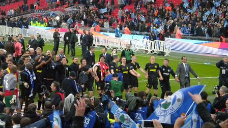 Wigan players celebrate thier FA Cup triumph right in front of the quartet of Ipswich Town fans at W
