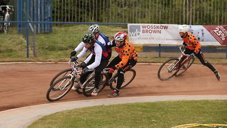 Sheffield's Jamie Bull attempts to split Lewis Roberts and Richard Williamson, while Matt Smith slid