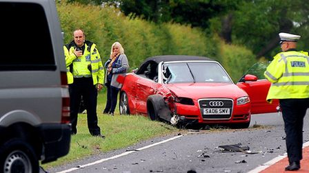 Traffic police attend the accident on the B1506 this morning.