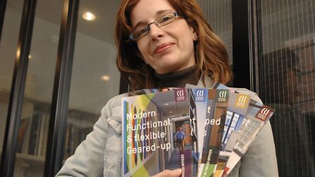 Silk Pearce designer Gail Russell with a series of brochures highlighting specific business services
