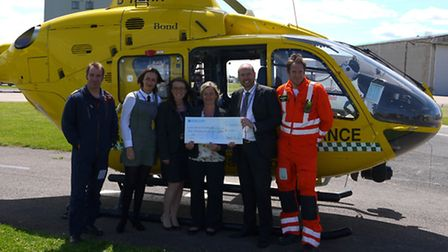 Claire Allan-Brooks, Claire Ward and Hayley Money of Baker Tilly presenting a check to Pip Duffy of