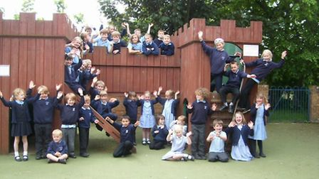 Pupils from Orford Primary School celebrate a 'good' Ofsted report.