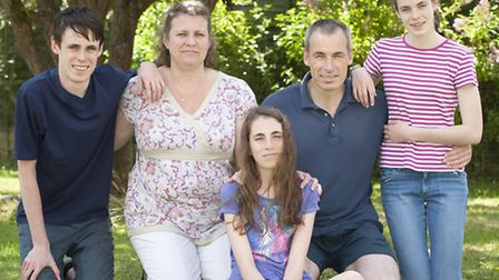 Claire (centre) is pictured with brother Marc, mum Isabelle, dad Jim and sister Anne