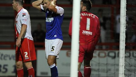 Tommy Smith holds his head in disappointment last night at Stevenage