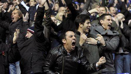 Ipswich Town's travelling fans celebrates as the Blues hold out for a hugely important 1-0 win at Bi