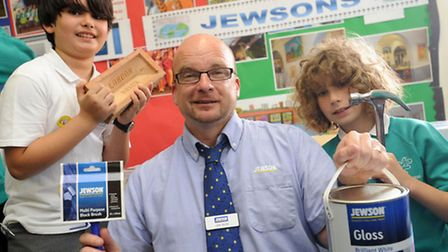 A careers fair at Melton Primary School. Jon Buck from Jewsons with Leo Gonzalez (10) and Jacob Thom