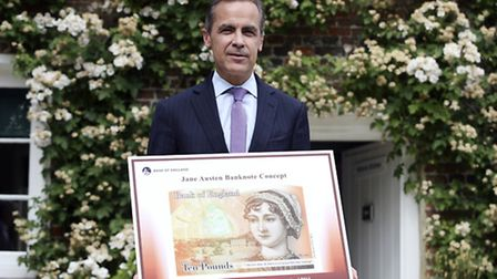 Mark Carney, governor of the Bank of England, holding the concept design for the new Bank of Englan
