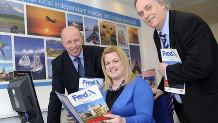 Gemma Deakin from the Ipswich branch of Fred. Olsen Travel with the new Fred.\ brochure, with Steve
