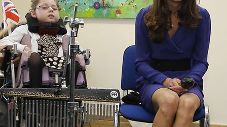 Duchess of Cambridge sits with Lea Clarke in a music class during her visit to the Treehouse, part