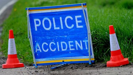A man is in hospital after his car was involved in a collision with a lorry and another car.