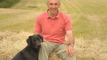 Graham Downing , chair of the Country Land Business Association, with his dog, Teal.