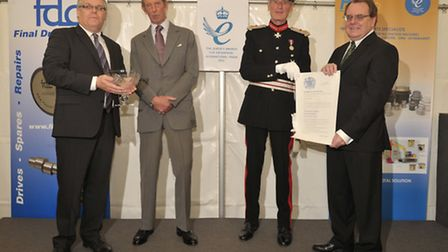 Richard Finch, left, and Robert Finch, right, of Plant Parts receive the companys Queens Award fro