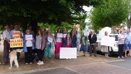 A group of villagers aired their frustration at plans to replace two disused buildings with new home
